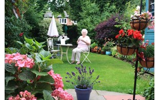 Norma Ogden Having A Drink In Her Garden On Warbeck Road
